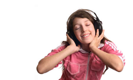 The girl listens to music in headphones photo