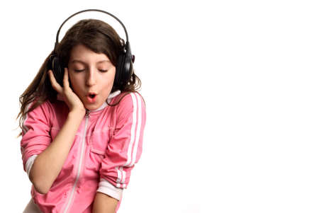 The girl listens to music in headphones Stock Photo - 724578