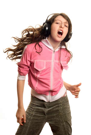 The girl listens to music and dances Stock Photo - 899329