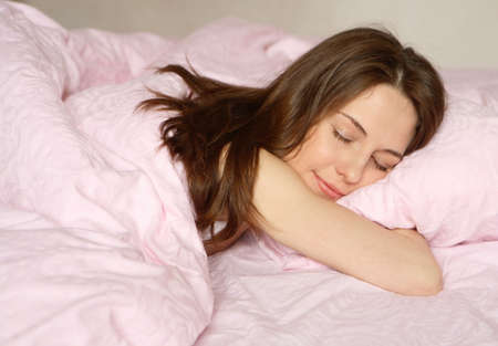 The girl sleeps on pink bed-clothes Stock Photo - 911503