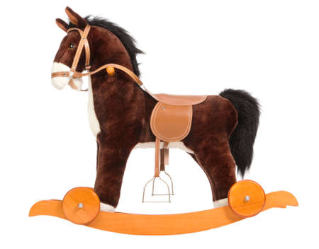 plush toy: Brown toy horse with a saddle, a bridle and wheels
