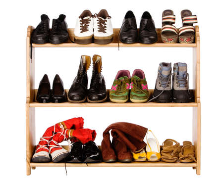 clothing rack: Shoes,  gym shoes, boots and other footwear stand on a rack Stock Photo
