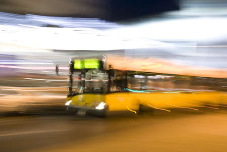 celerity: The yellow bus quickly goes on an evening city Stock Photo