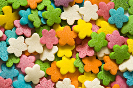 florets: Confectionery ornaments in the form of multi-coloured florets close up Stock Photo