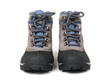 Mans waterproof boots with laces close up on a white background