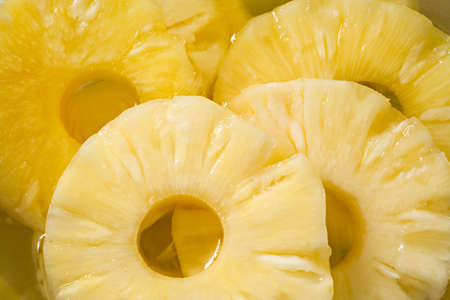 compote: Pineapple compote with circles of pineapple close up Stock Photo