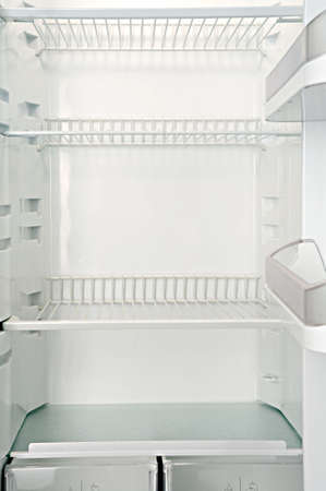 scarcity: Interior of an empty open white refrigerator
