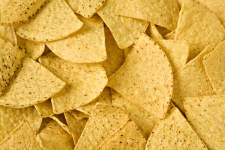 Yellow triangular chips close up in all shot photo