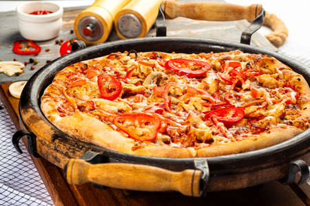 whole italian pizza in a pan, decorated