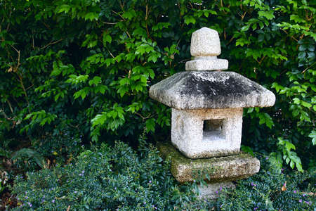 Japanese stone lamp in japanese garden