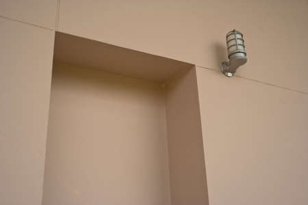 A lamp and wall