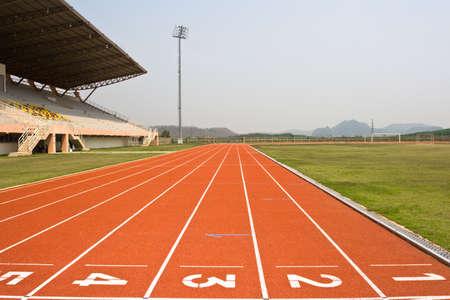 A university running track, around an grass football field. Stock Photo