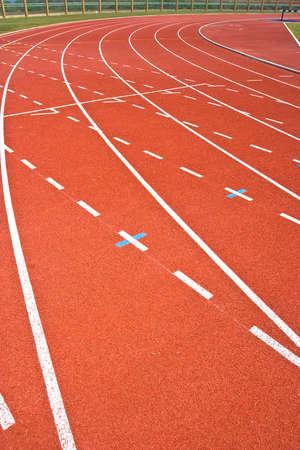 A university running track, around an football field.