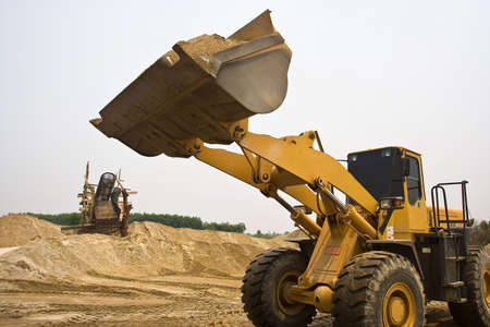A wheel loader working in a constuction site. Stock Photo