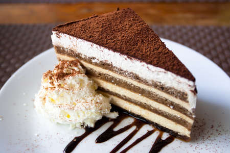 A pice of cake on a white dish.