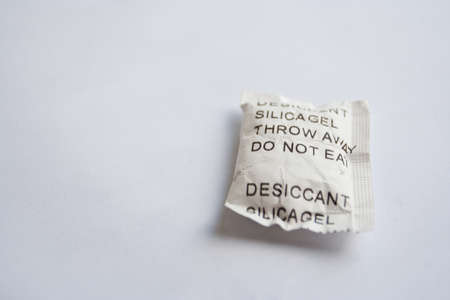 silica: A bag of silicagel on white background.