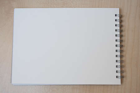 An empty drawing book on a desk. photo