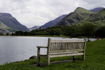 A bench face toward a lake in Llanberis  Stock Photo - 14926147
