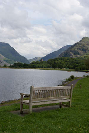 A bench face toward a lake in Llanberis  Stock Photo - 14926151