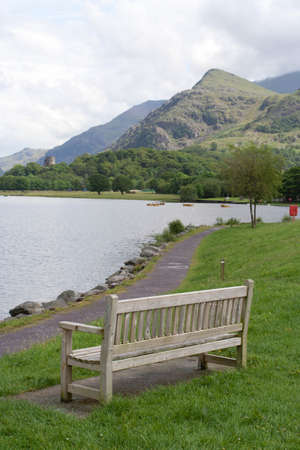 A bench face toward a lake in Llanberis  Stock Photo - 14926158