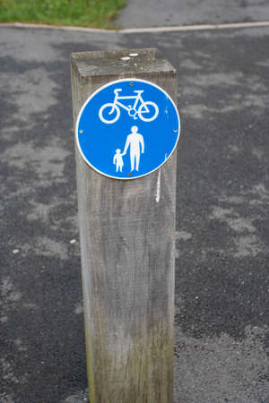A road sign warning about family and bicycle  photo