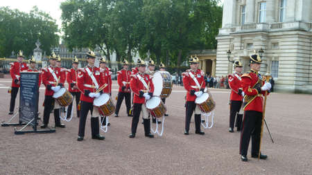 A group of soldier marchimg from their baruck to the Buckingham Palace