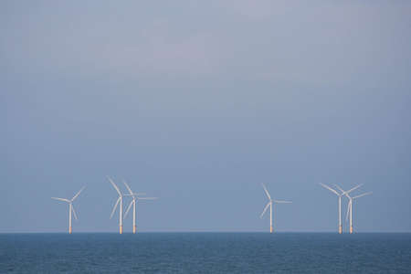 Wind turbines operating at sea  photo