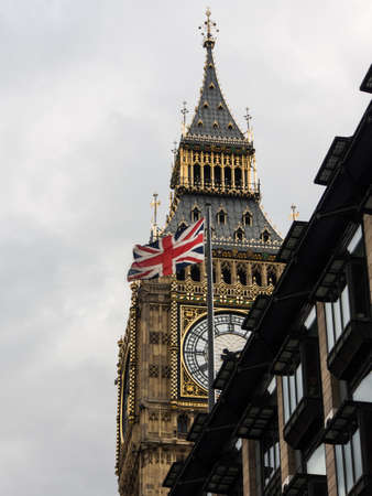 bigben: Bigben and british flag in a cloudy day