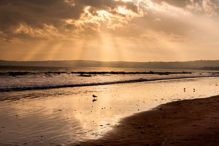 light beam fron the sun at the beach of Swansea  Stock Photo - 16295059