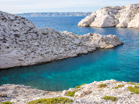 Mediterranean sea with rocky background and small plants on the foreground in Chateau d Stock Photo - 16482333