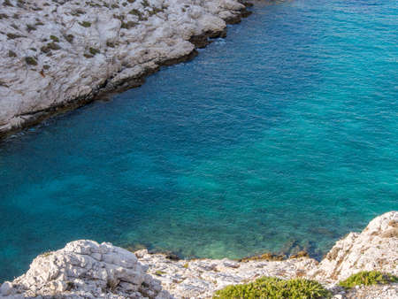 Mediterranean sea with rocky background and small plants on the foreground in Chateau d Stock Photo - 16482338