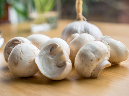 buttom: a group of Buttom mushroom and garlic on wooden board