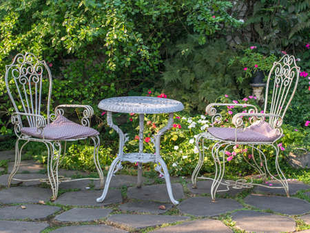 Table and chairs  in a garden in thailand. Stock Photo