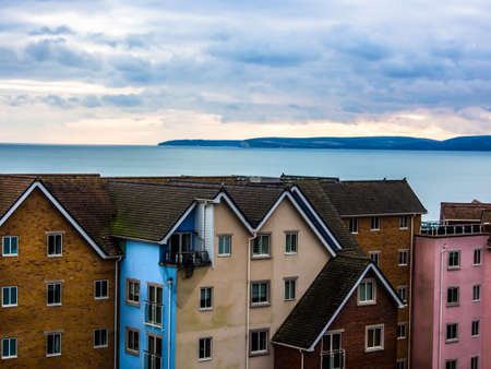 Houses by the sea in UK. Stock Photo