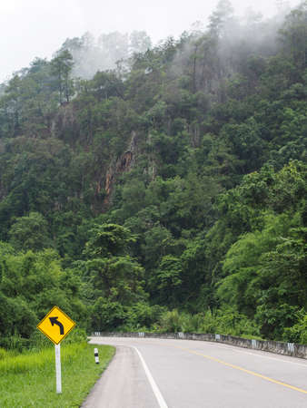 A road leading to a rain forest in northern thai. Stock Photo