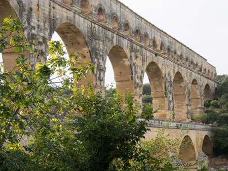 The  ancient Roman aqueduct bridge in France. Stock Photo