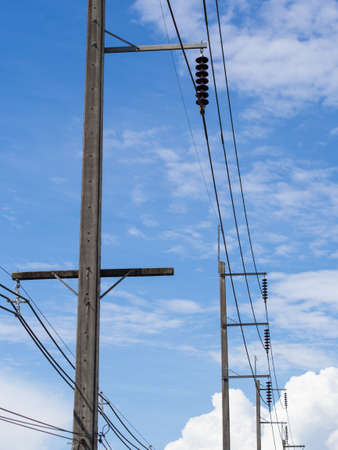 Electric pole and wires and couldy sky. Stock Photo