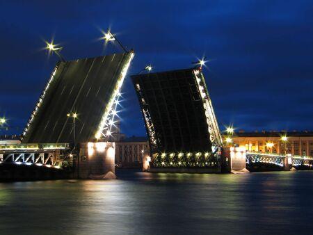 Night view of raised Palace Bridge in St.Petersburg, Russia. photo
