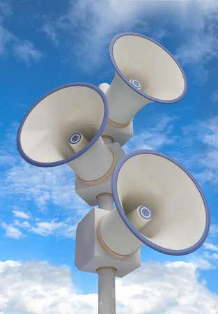 Three megaphones on the pole photo