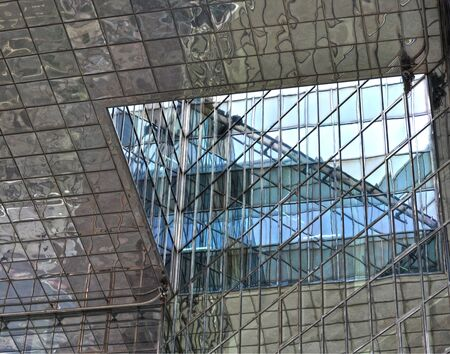 architecture abstract: Reflections on the glass of a London building.