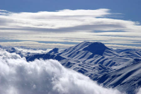 Bright white Clouds and snow mounains (Turkey) photo
