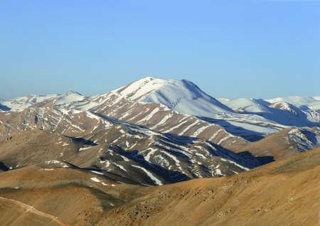 Spring in the Mountains. Snowy peak (Turkey) photo