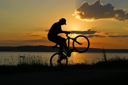 Jump with a mountain bike and yellow sunset Stock Photo