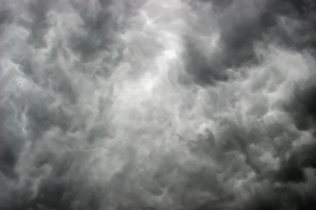 awful: amazing awful dark gray clouds with bright gleams Stock Photo