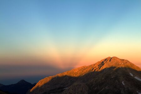 diverging: Anticrepuscular rays - diverging fan of rays observed at sunset on the side opposite to the sun