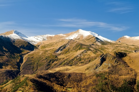 Autumn in the mountains of the North Caucasus. Green mountain with the glacier