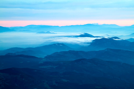 far mountains with blue haze and clouds (sunset or sunset)