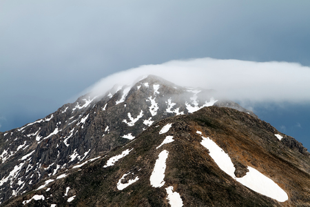 Spring views of the snowy mountains of the Turkey. Formation and movement of clouds over mountains peaks. Stock Photo