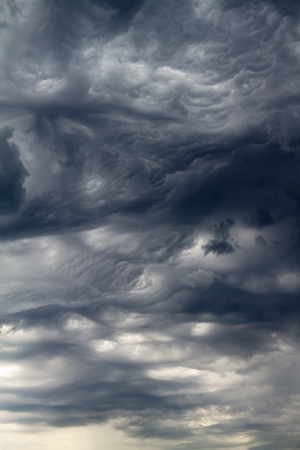Beautiful rare clouds of dramatic appearance. Summer in the European part of Russia.