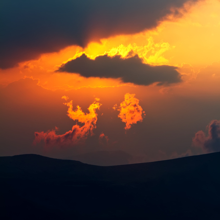 Soft focused at the cloud on the sunset look like a phoenix bird by shape and color.